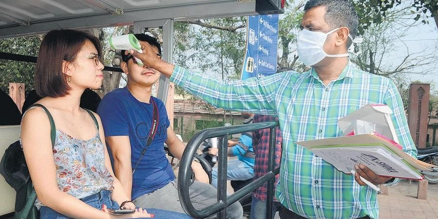 An official uses a thermal screening device on tourists in the wake of deadly Coronavirus outbreak, on Thursday in Agra.