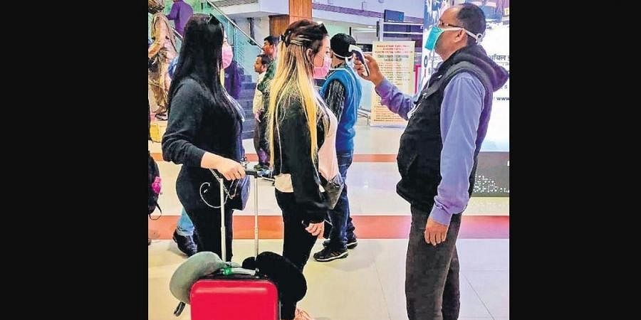 Passengers being screened at the Lokapriya Gopinath Bordoloi International Airport in Guwahati on Saturday