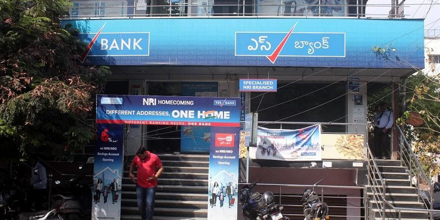 Account holders of Yes Bank are seen at Dilsukhnagar branch in Hyderabad