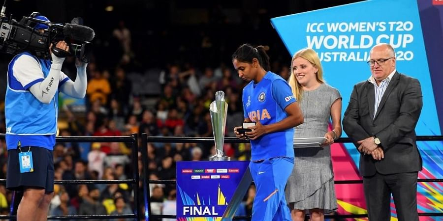 India's captain Harmanpreet Kaur walks past the trophy during the ceremony of the Twenty20 women's cricket World Cup final between Australia and India in Melbourne. (Photo | AFP)