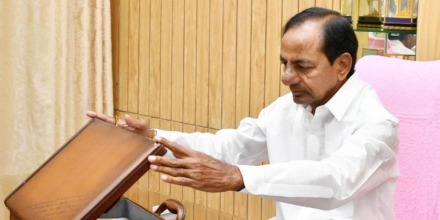Telangana CM K Chandrasekhar Rao looking at the budget copy for the year 2020-21 in Telangana Assembly in Hyderabad