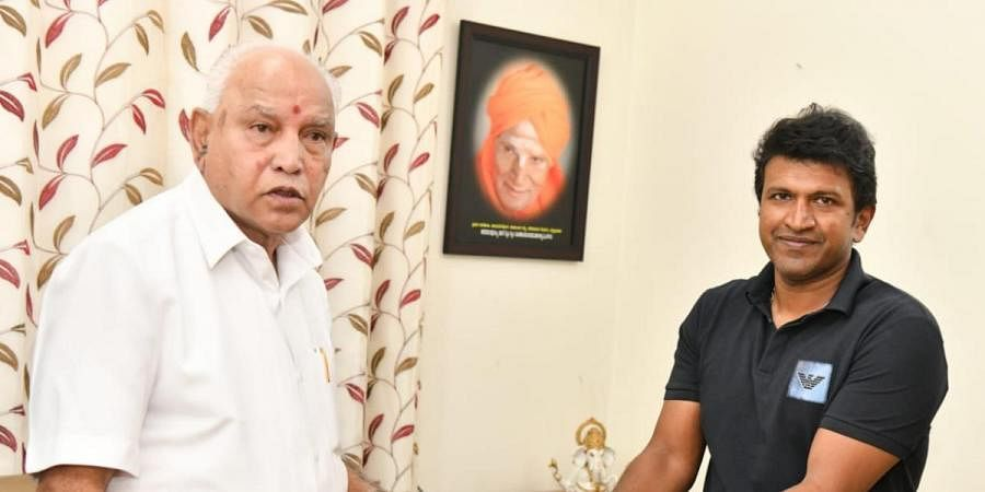 CM BS Yediyurappa and Puneeth Rajkumar