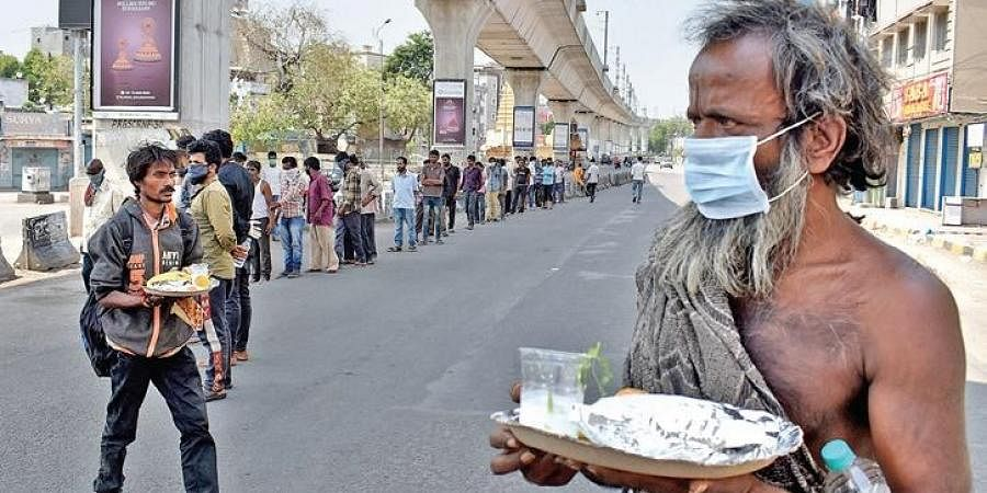 Homeless queue up for food at Secunderabad railway station on Sunday. (Photo   S Senbagapandiyan, EPS)