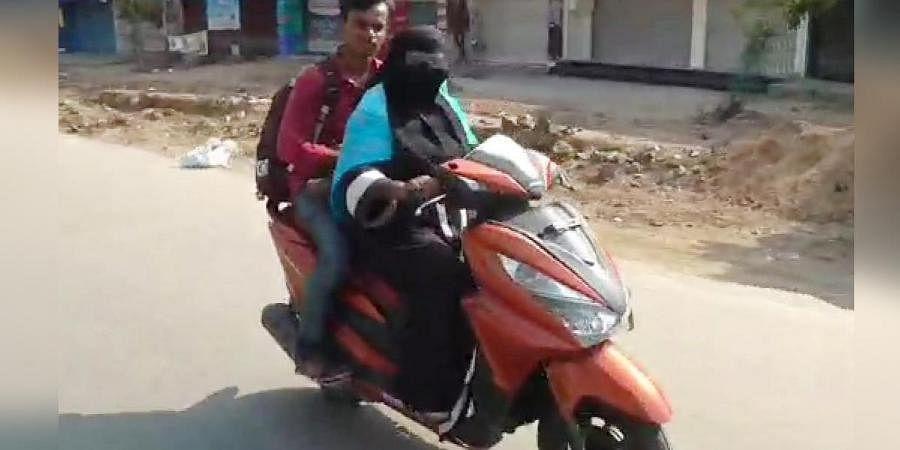 Rajiya Begum ferrying her son Nizamuddin back home from Nellore