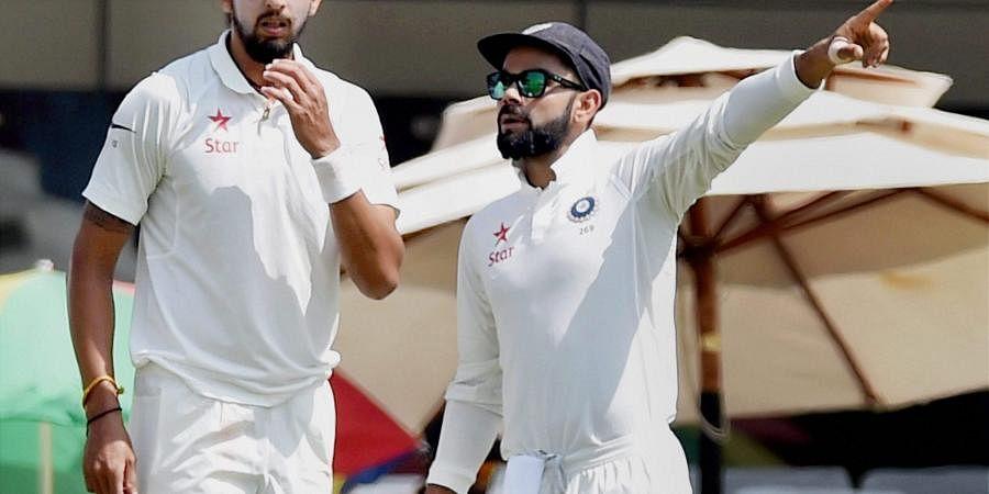 Indian skipper Virat Kohli with bowler Ishant Sharma. (File | PTI)