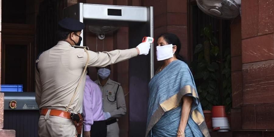 Finance Minister Nirmala Sitharaman being checked at the Finance Ministry entrance during the 20th day of Lockdown in New Delhi