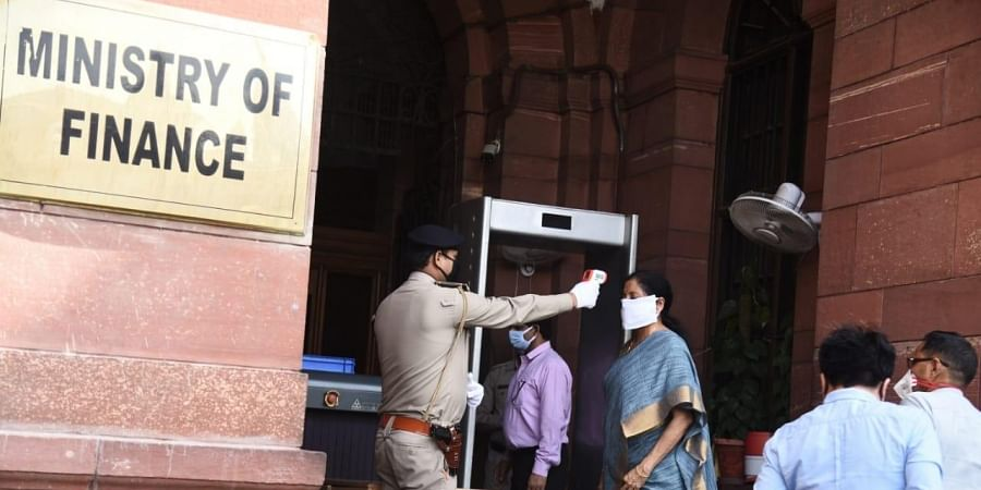 Finance Minister Nirmala Sitharaman being checked at the Finance Ministry entrance during the 20th day of Lockdown in New Delhi.