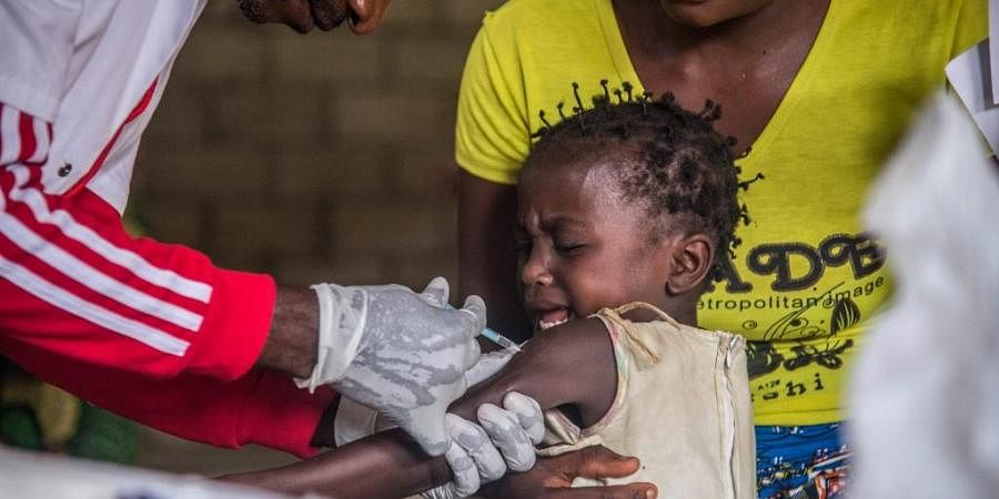 A toddler undergoes measles vaccination. (Photo| AFP)