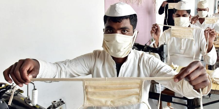risoners wear protective masks as they stitching face masks inside Netaji Subhash Chandra Bose central jail, in Jabalpur