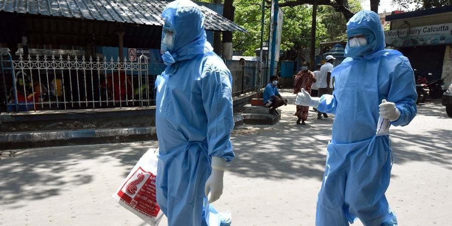 Health officials dressed in protective suits and masks at NRS hospital during a government-imposed lockdown as a preventive measure against the coronavirus, in Kolkata