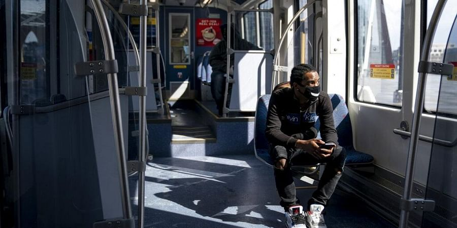 A rider on an almost empty Light Rail during the p.m. rush hour to meet someone in Minneapolis, Monday, April 13, 2020, during the coronavirus outbreak.