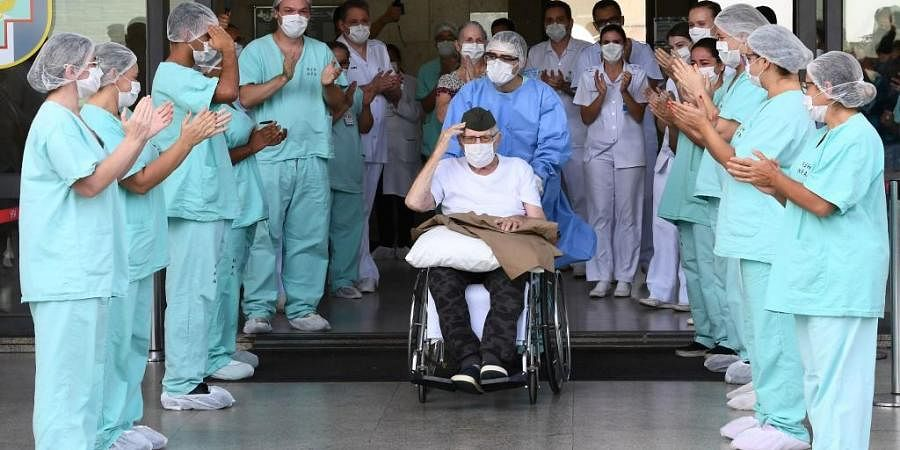 Brazilian 99-year-old former WWII combatant Ermando Armelino Piveta, gestures as leaves the Armed Forces Hospital in Brasilia, after being treated for the novel coronavirus COVID-19 and discharged, on April 14, 2020.