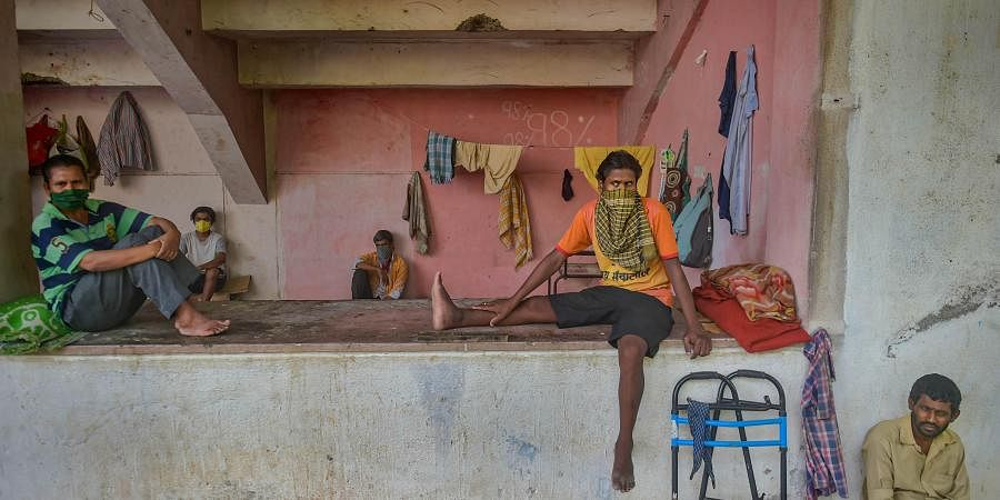 Migrant workers and homeless people rest at a temporary camp set up on the premises of a stadium during ongoing COVID-19 lockdown in Thane Wednesday.