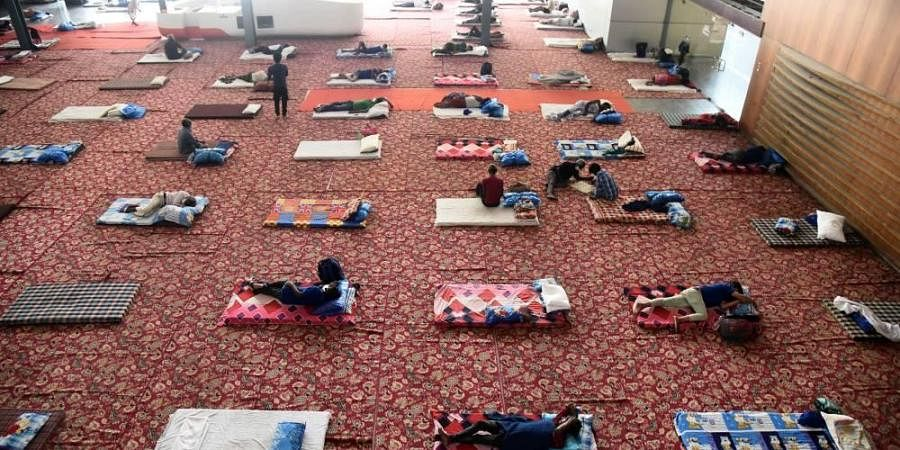 Migrants at Yamuna Sports Complex which has been converted into a temporary shelter for those in need during the government-imposed nationwide lockdown.