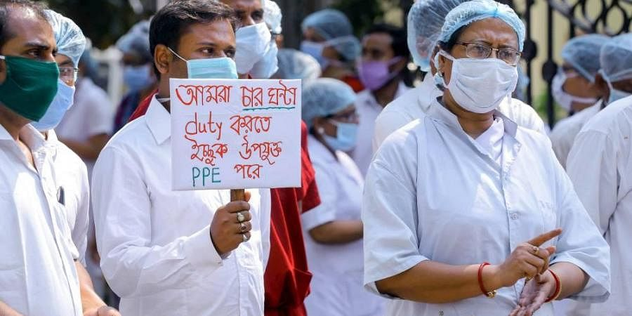 Nurses and medical staff stage a protest over the inadequate supply of Personal Protection Equipment PPE in wake of the coronavirus pandemic at Howrah Orthopedic Hospital