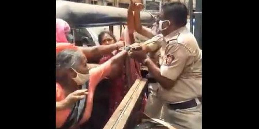 A scuffle broke out between a hawker and police personnel yesterday after she was not allowed to sell vegetables in a containment area in Mankhurd.
