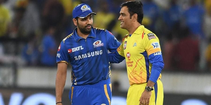 Mumbai Indians cricket team captain Rohit Sharma (L) and Chennai Super Kings captain Mahendra Singh Dhoni. (Photo | AFP)