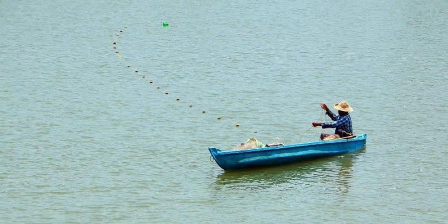 A man fishing in Korappuzha river at Kuniyilkadavu bridge in Kozhikode.