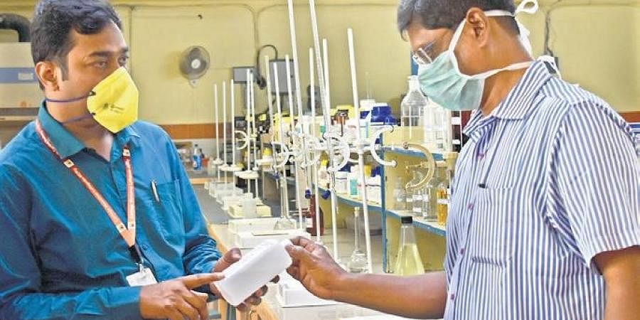 A chemical and metallurgical laboratory making hand sanitiser for Southern Central Railway staff
