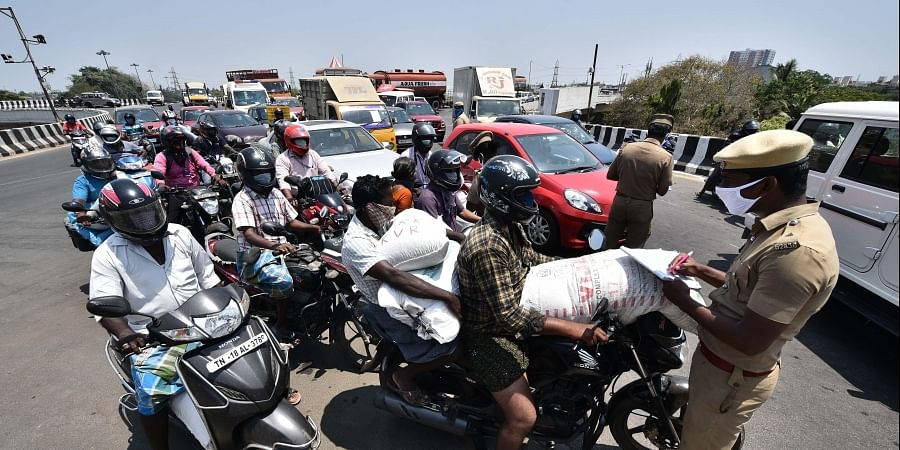 olice check the vehicles while the lock-down in progress following covid-19 on Padi flyover in Chennai.