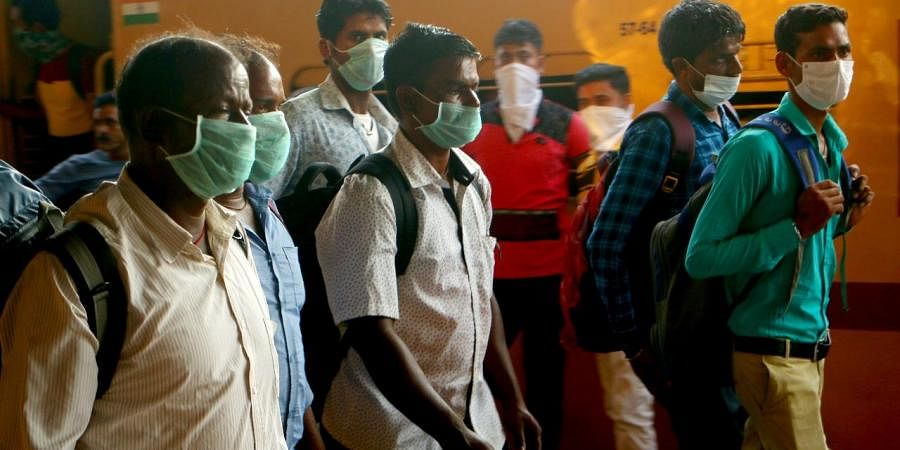 People wear masks at the Kerala station. (Photo| EPS/ TP Sooraj)