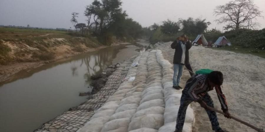 Flood protection works are carried out in a riverbed in Bihar