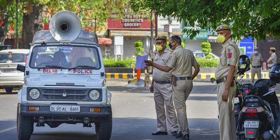 Delhi Police personnel stand guard at Bengali market which has been identified as a containment zone during the nationwide lockdown to curb the spread of coronavirus in New Delhi. (Photo | PTI)