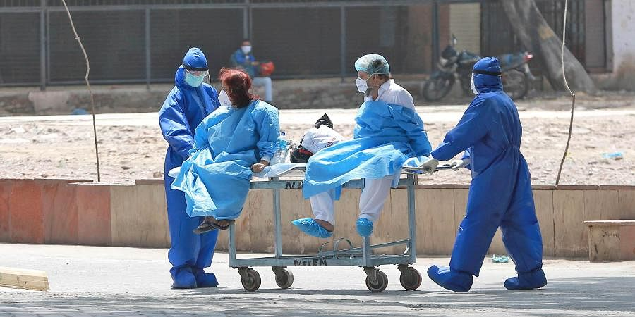 Tablighi Jamaat members showing tested negative for covid-19 being transported to quarantine centre from LNJP hospital in New Delhi.
