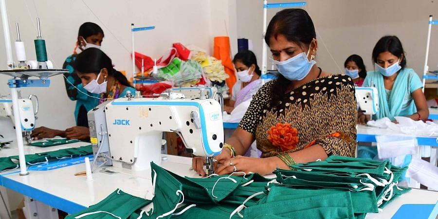 Women stitch cloth masks at Tavarakere Bengaluru Rural