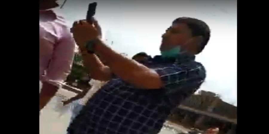 The clip shows Congress MLA from Gujarat standing behind the jawan and making a gesture as if he would hit him.