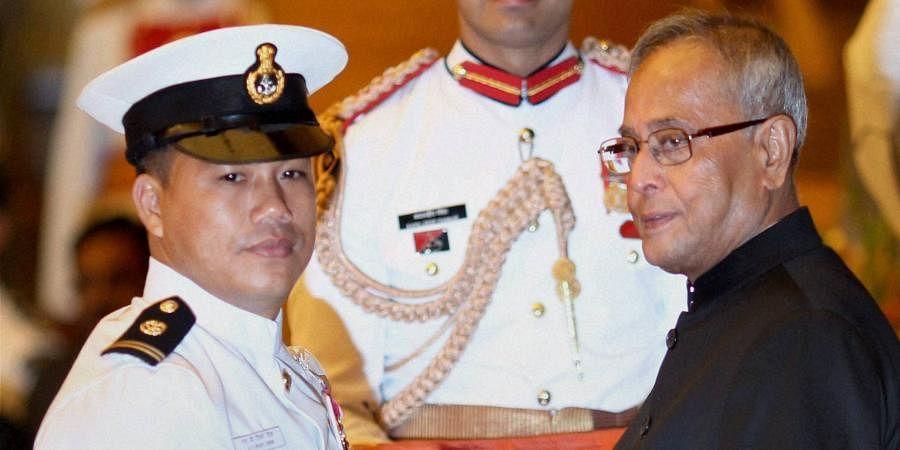 Then President Pranab Mukherjee presents Padma Shri to boxer Ngangom Dingko Singh.