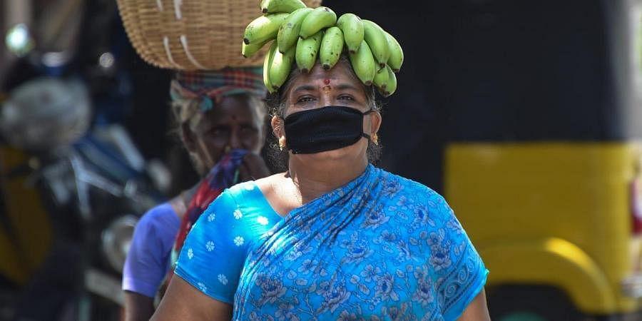 A woman wears masks for protection against COVID-19. (Photo| EPS/Ashok Kumar)
