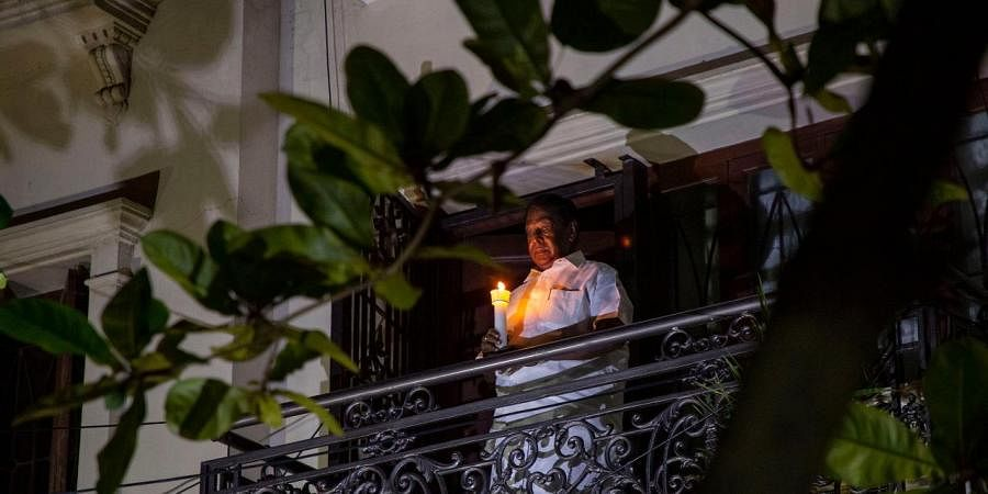 Puducherry Chief Minister V.Narayansamy lit a lamp at his balcony on Sunday to show his solidarity to end the 'darkness' of coronavirus' as requested by Indian Prime Minister.