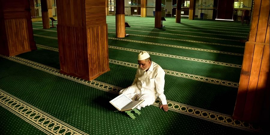 Abdhul Hameed Musliyar, the muezzin of Muaddun Juma Masjid, Kaloor, recites Quran on the eve of the start of the holy month of Ramzan. Hundreds used to perform namaz at the masjid before the Covid outbreak, but now he is all alone due to the lockdown restrictions.