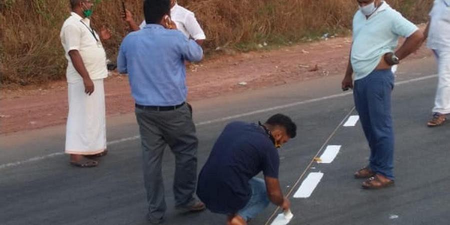 Survey officials marking the border at Thalapady