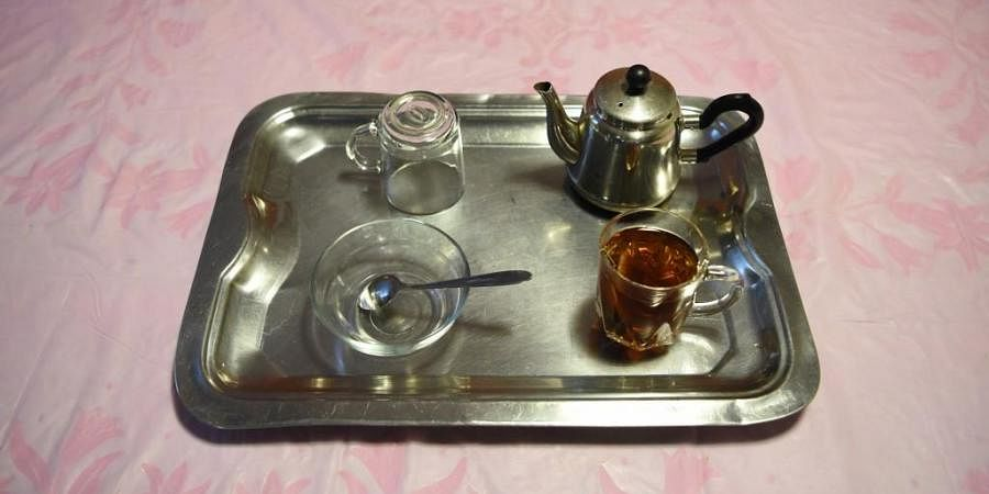 This photograph taken on April 21, 2020 shows a tray containing a cup of black tea, an item that has been in short supply in Afghanistan as a result of the COVID-19 novel coronavirus, in Kabul. The winner for most bizarre shortage of 2020 is Afghanistan, where a rumour about a mustachioed newborn advising the purchase of black tea people flocking to the shops.  (PHOTO   AFP)
