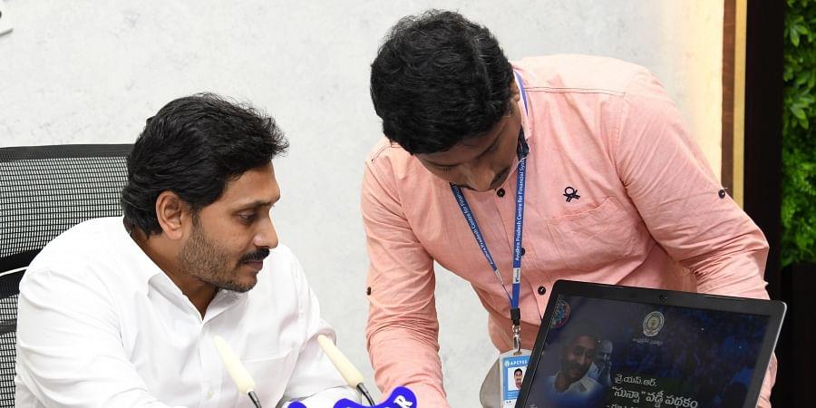 Andhra Pradesh CM YS Jagan Mohan Reddy launches YSR Sunna Vaddi scheme at CM's camp office in Tadepalli on Friday.