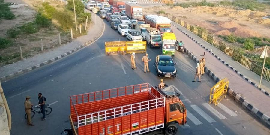 Police are conducting checks at the Delhi-Ghaziabad border during coronavirus lockdown, on Thursday