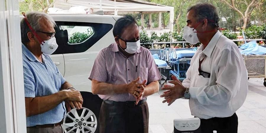 Union Health Minister Dr Harsh Vardhan sanitizes his hands as he arrives to visit AIIMS Trauma center which has been converted to dedicated COVID-19 Hospital, in New Delhi