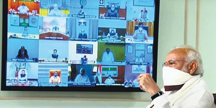 PM Narendra Modi wearing a protective mask chairs a video meeting with CMs on COVID-19.