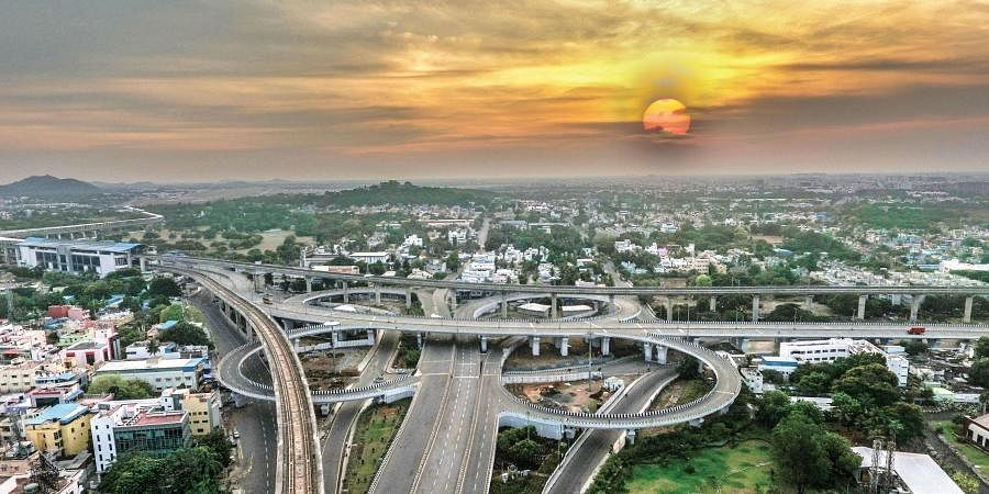 Kathipara flyover's bends and curves wave a silent goodbye to the setting sun in the city on Sunday | seshadri sukumar