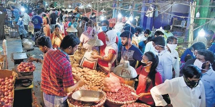 Crowded Koyambedu vegetable market on Saturday when residents thronged there after the government announced four-day intense lockdown | Martin Louis