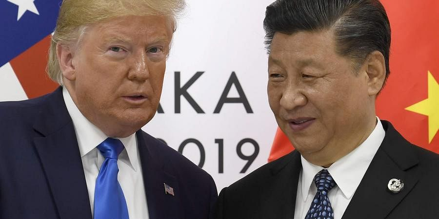 U.S. President Donald Trump poses for a photo with Chinese President Xi Jinping. (Photo | AP)