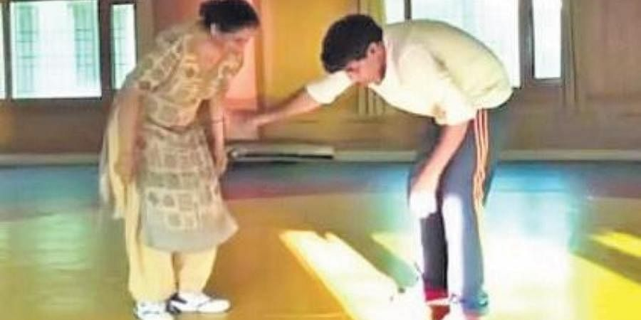 On Monday, NIS Patiala wrestling coach OP Yadav took the help of his wife to demonstrate wrestling moves for an online teaching module.