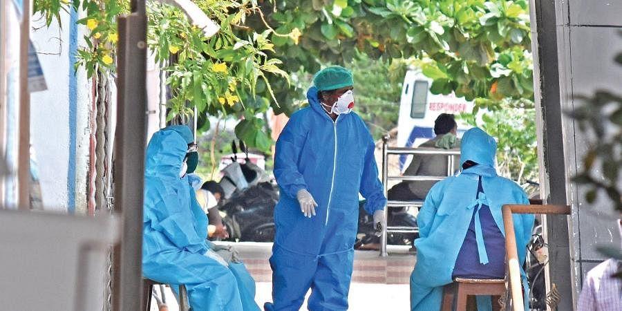 Medical staff at the COVID-19 hospital in Vijayawada on Sunday.
