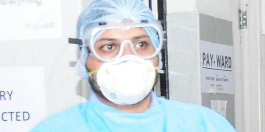 A nurse wearing a n95 mask at Thrissur Medical College Hospital