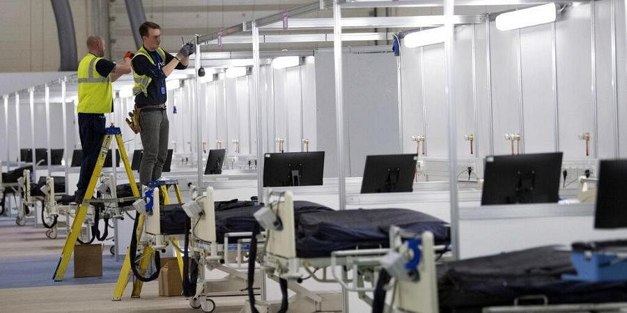 In the fight against the coronavirus pandemic, soldiers are delivering millions of face masks to hospitals and helping to build makeshift medical facilities, including one at London's ExCel convention center that can treat as many as 4,000 patients.