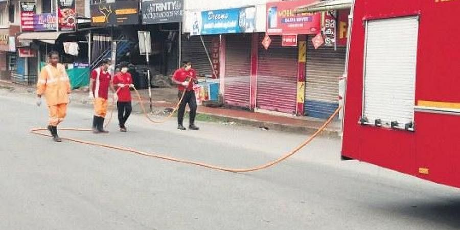 Volunteers of Kerala  Voluntary Youth Action Force engaged in sanitising public spots