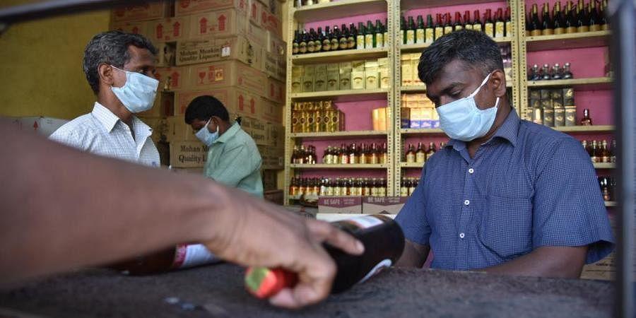 The coronavirus fear has no limit. Tasmac employees seen wearring face mask in Chennai.