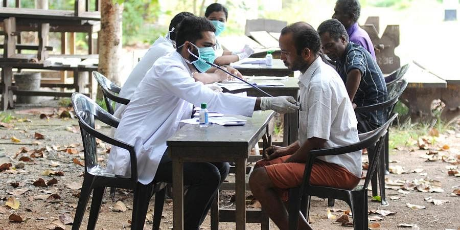 Doctors conducting checkups at Govt Girls Higher Secondary School as part of a sanitation drive against COVID-19 in Kochi